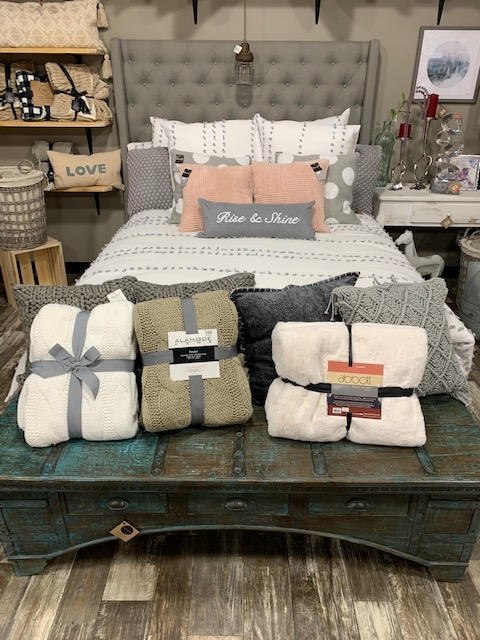 white and grey bedspread display
